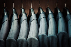 Row of men suit jackets on hangers Stock Image