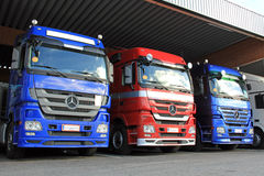 Row of Mercedes-Benz Actros Trucks in Carport stock photography