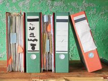 Row of messy file folders, Royalty Free Stock Photography