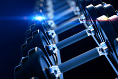 Row of metal dumbells Stock Images