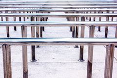 Row of metal hand handrails background in the stadium royalty free stock photos