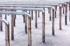 Row of metal hand handrails in the park. Background stock photo