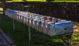 Row of Metal Mailboxes With Flags Up Royalty Free Stock Photography