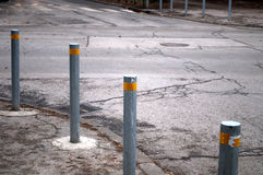 Row metal poles along the road to control the movement of the car. In Novi Sad, Serbia Stock Photography