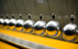 Row of metallic balls for inertia experiments Royalty Free Stock Photography