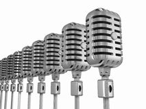 Row of microphones. Couple of microphones on a stand Royalty Free Stock Photo