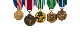 Row of military medals. Row of various military medals on a white background Royalty Free Stock Photo