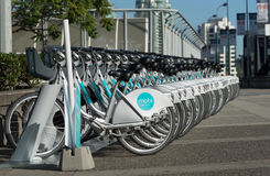 Row of MOBI public bikes for rent. Stock Images