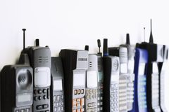 Row of mobile phones Stock Photos