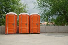 Portable Toilets on an Event. Row of mobile toilets in an urban area stock photo