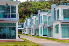 Row of modern beautiful villas on the asian resort in holiday village Stock Photos