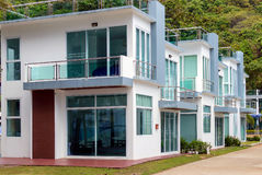 Row of modern beautiful villas on the asian resort in holiday village Royalty Free Stock Photos