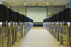 Row of Modern Chairs Standing in Line in The Empty Auditorium Stock Photos