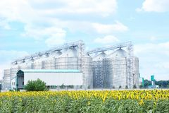 Row of modern granaries for storing cereal grains stock images