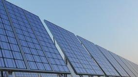 Row of modern solar panels against blue sky. Renewable energy generation, CGI. Row of modern solar panels against blue sky. Renewable solar energy Stock Photo