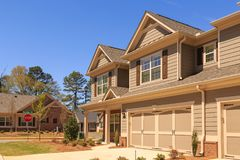 New Siding Townhome in Neighborhood. A row of modern townhouses in a new subdivision Stock Photo