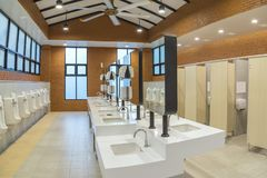 Row of modern white ceramic wash basin in public toilet. Or restaurant or hotel or shopping mall, interior design Royalty Free Stock Images