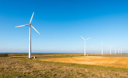 Row of modern wind turbines in a rural landscape Stock Photos