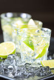 Row of mojito cocktails on a dark background with lime and ice Royalty Free Stock Images