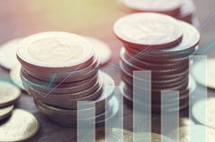 Row of money coins with graph. Of finance and account background Stock Photo