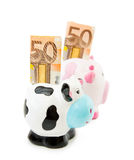 Row of money - Piggy banks Stock Images