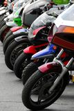 Row of motocycles. Parked on a street in front a motorcycle store Stock Photo