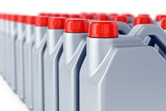 Row of motor oil jerry cans. Group of motor oil grey plastic jerry cans with red lids on white background. Heavy industry, warehouse, shipping and manufacturing Royalty Free Stock Photo