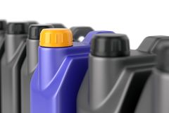 Row of motor oil jerry cans. Unique motor oil plastic jerry can among a group of ordinary ones. Business leadership, uniqueness and outstanding quality advantage Royalty Free Stock Photos