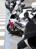 Row of motorbikes. One Row of parked motorbikes Royalty Free Stock Photos
