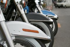 Row of motorcycle front wheels Royalty Free Stock Photo