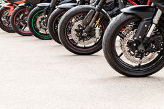 Row of  motorcycle wheels Royalty Free Stock Images