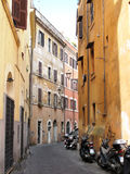Row of the motorcycles on the old street in Roma Royalty Free Stock Photography
