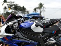 Row of motorcycles at show. Row of motorcycles at outdoor show in Koh Chang, Thailand Royalty Free Stock Photos