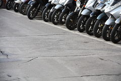Row of motorcycles on street. Showing only the front tires, fenders and headlights Royalty Free Stock Images