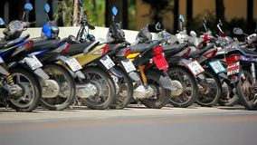 Row of motorcycles on the street. Thailand video Stock Photos