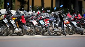 Row of motorcycles on the street. Thailand video Royalty Free Stock Photo
