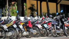 Row of motorcycles on the street. Thailand video Stock Photography