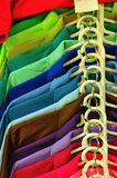 Row of Multi color T-shirt. For use as Background Stock Photography