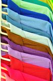 Row of Multi color T-shirt. For use as Background Royalty Free Stock Image