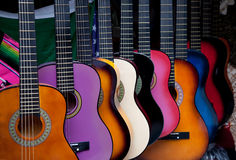 Row of multi-colored Mexican guitars stock photography