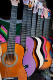 Row of multi-colored mexican guitars Stock Photo