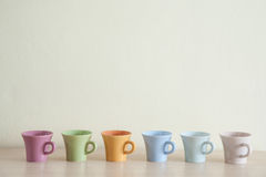 Row of multicolor coffee cups Stock Photography