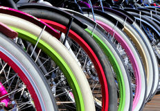 Row multicolored bicycle wheels closeup Royalty Free Stock Photos