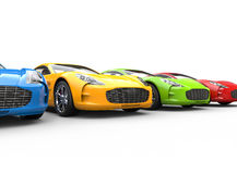Row of multicolored cars on white background Royalty Free Stock Photo