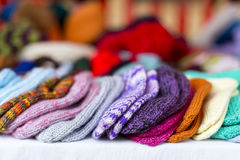 Row of multicolored hand-knitted baby socks Royalty Free Stock Photo