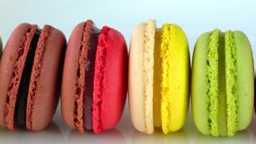 Row of multicolored Macaroons. Isolated on white background stock video footage