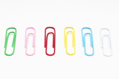Row Of Multicolored Paper Clips. Row of multi colored paper clips over white background Royalty Free Stock Image