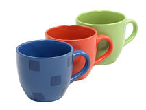 The row of multicolored tea cups. Stock Photos