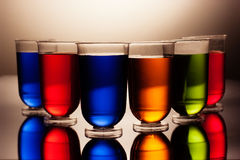 Row of multicoloured alcohol drinks Royalty Free Stock Photography