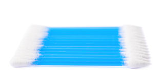 Row of multiple cotton swabs isolated Stock Images
